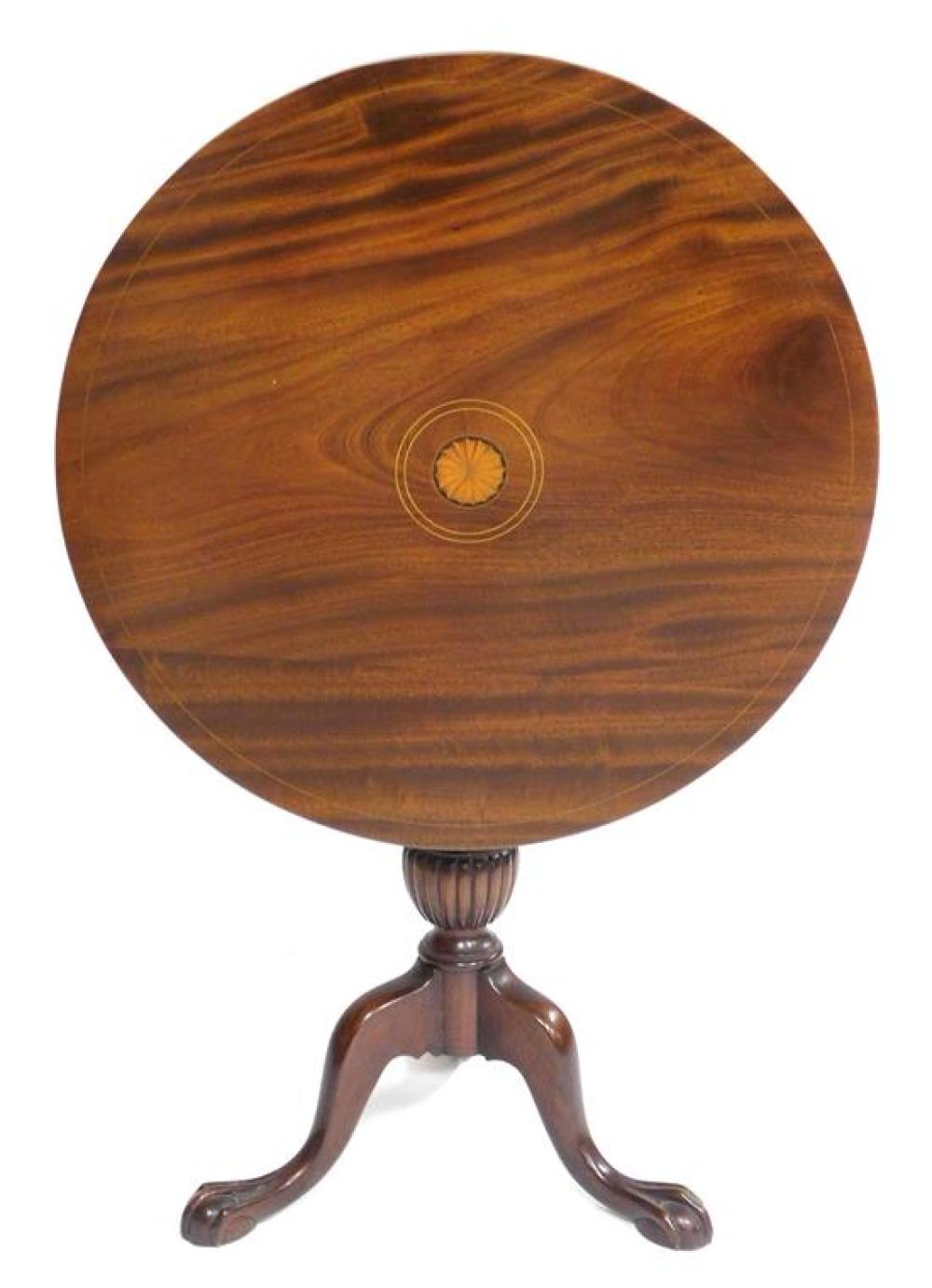 Chippendale style tilt top stand, round top with inlaid pinwheel and stringing, urn carved standard with reeding, raised on three ca...