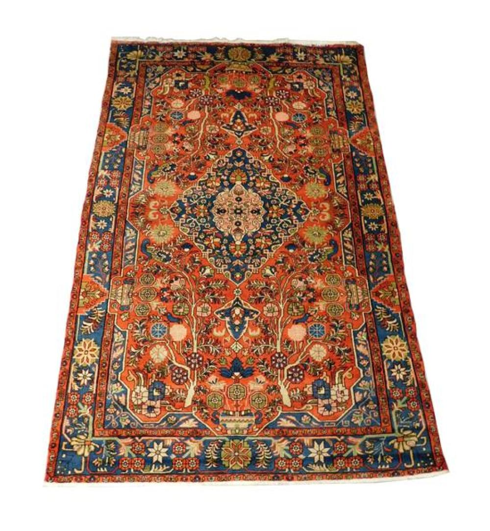 """RUG: Persian, 9' 10"""" x 6' 4"""", 100% wool on cotton, large blue medallion on terra cotta field, peacock bird and floral designs surrou."""