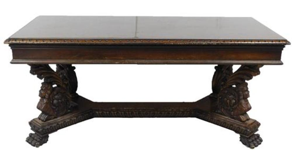 Library table, oblong top with figural scroll and paw carved base, mahogany finish, wear consistent with age and use, sold as is, sc...