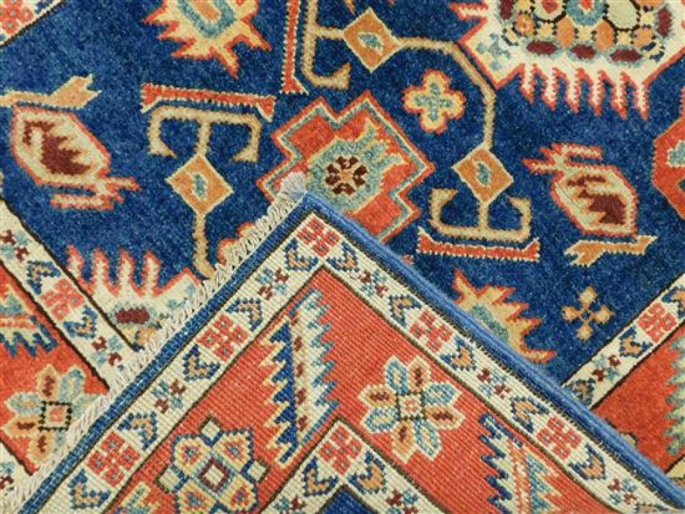 "RUG: Uzbek Kazak, 2'9"" x 9'10"", hand-knotted, 100% wool on cotton, navy ground with serrated vine design, brick red border with crea."