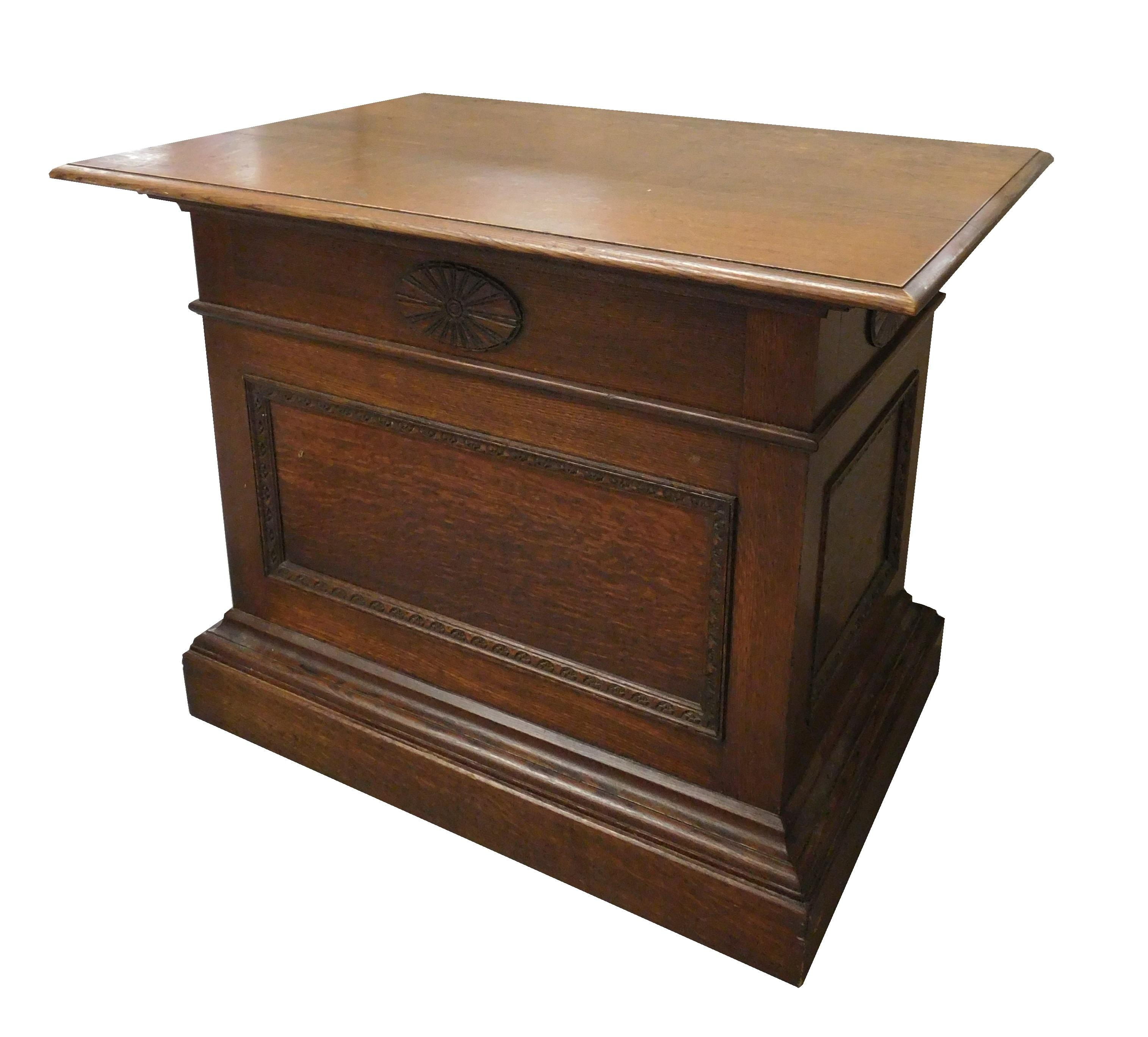 Oblong oak stand with paneled sides and stepped molding base, wear consistent with age and use, 34' h. x 30' w. x 42' d.