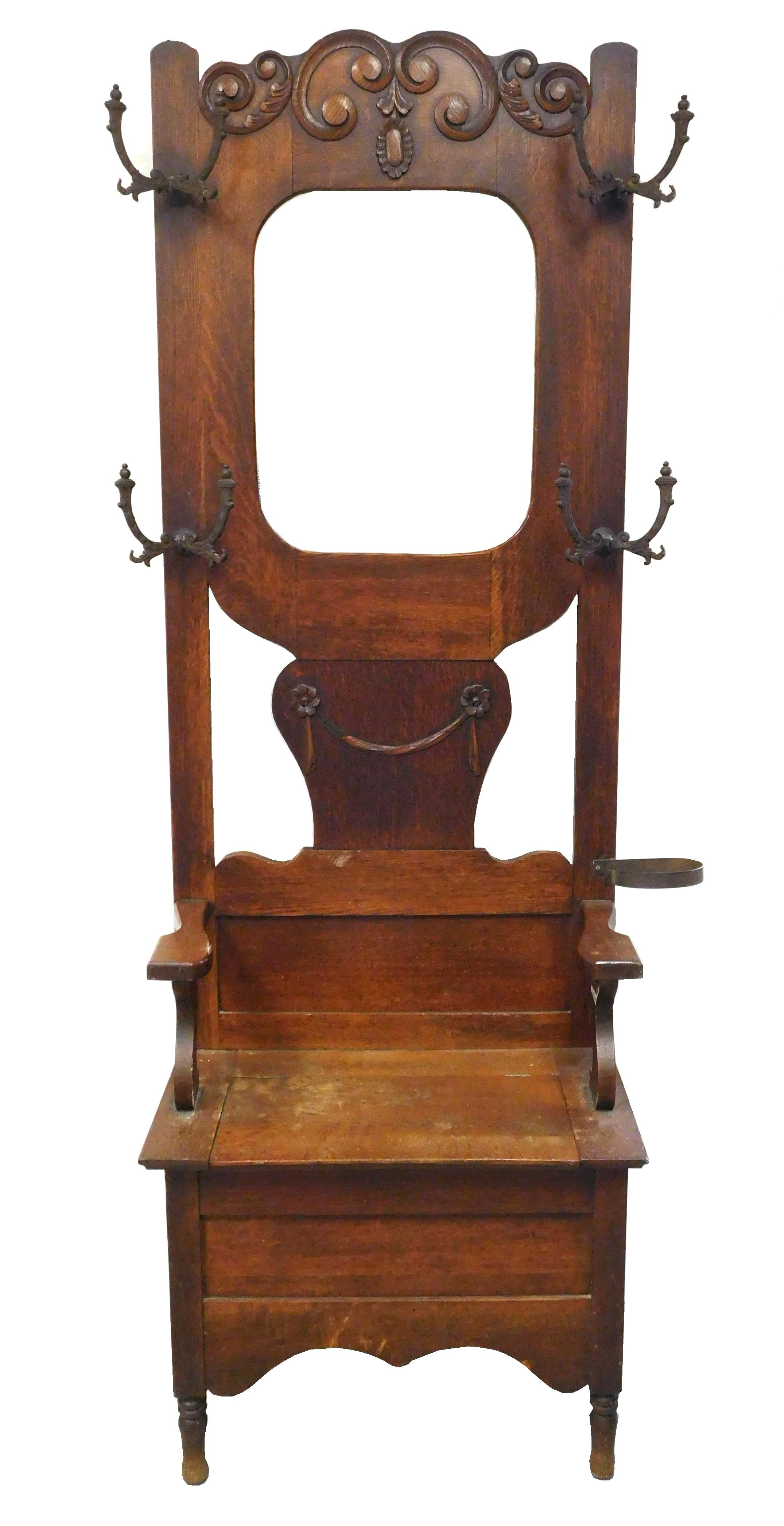 Victorian hall rack with lift seat, oak, oblong beveled mirror, scroll and swag carvings, wear consistent with age and use including...