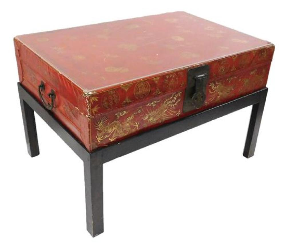 ASIAN: Red lacquer storage box stand, Chinese, box decorated with gold colored foliate, dragon and phoenix, designs, metal handles a...