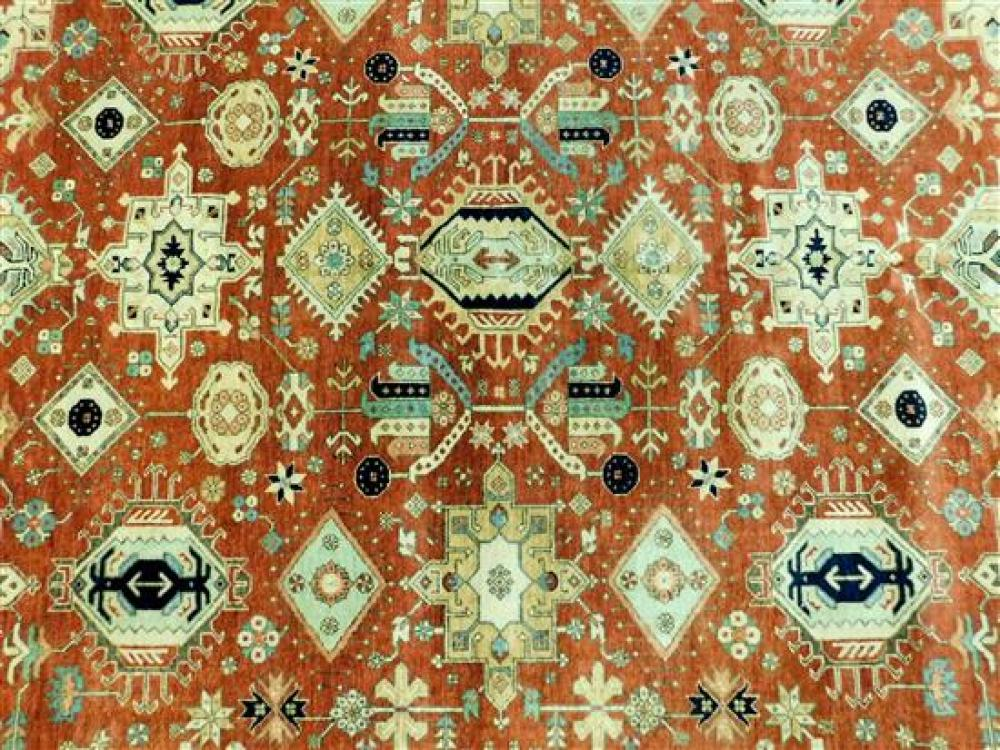 RUG: Laristan Karajeh, 8' x 10', hand-knotted, 100% wool on cotton, repeating angular medallions on an apricot field, latch and flor.