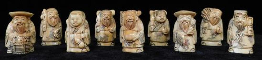 """ASIAN: Nine carved bone diety netsuke, Japanese, early 20th C., wear consistent with age and use, all figures 2""""h. x 1""""w x 1""""d.. [NO..."""