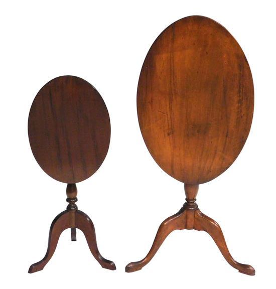 Two queen Anne style candlestands, 20th C., including: smaller by C. Dodge Furniture Co., Manchester-by-the-sea, Mass., ovoid shape...