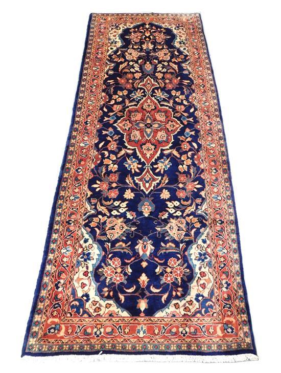 """RUG: Persian, 9' 2"""" x 3' 7"""", 100% wool on cotton, rust medallion on blue field with rust border and cream corners, wear consistent w."""