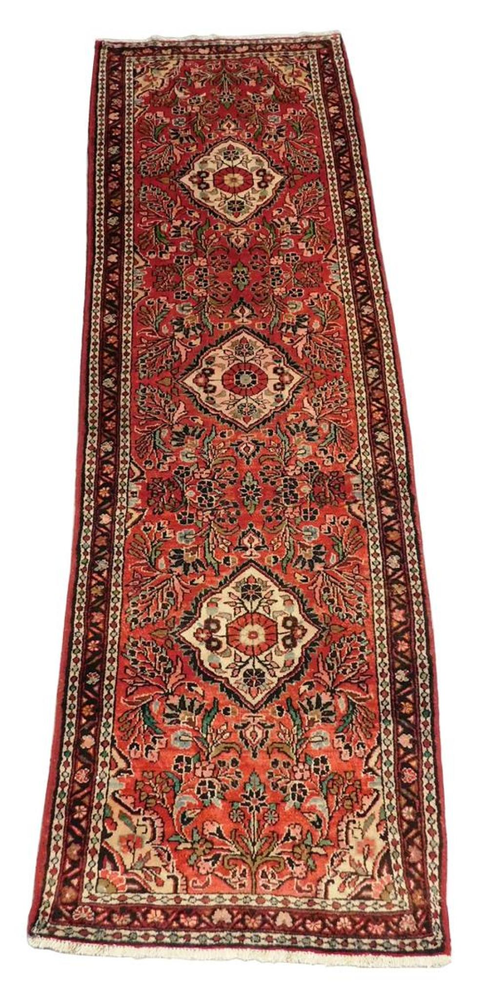 """RUG: Persian Hamadan, 10' 6"""" x 3' 3"""", 100% wool on cotton, three medallions on red field, chocolate brown, very good condition but c."""