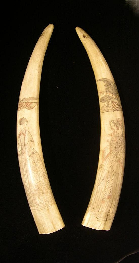 Two similar scrimshaw decorated walrus tusks each with full length portrayal of woman in dress, c. 1860, below vignettes one with ea...