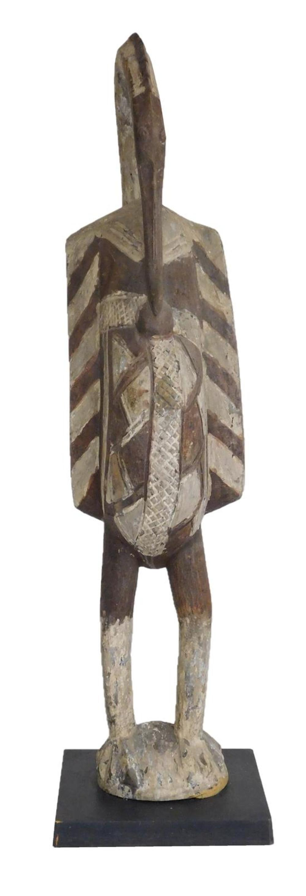TRIBAL: Senufo Porpianong Bird, Ivory Coast, 20th C., made for the tourist trade, wood with pigment, large carved wood figure of a p...
