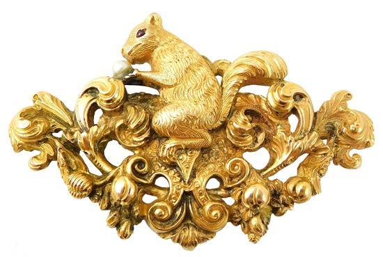 JEWELRY: 18K Yellow gold squirrel brooch with loop for a lady's watch, elaborate design with squirrel in profile seated on top of a ..