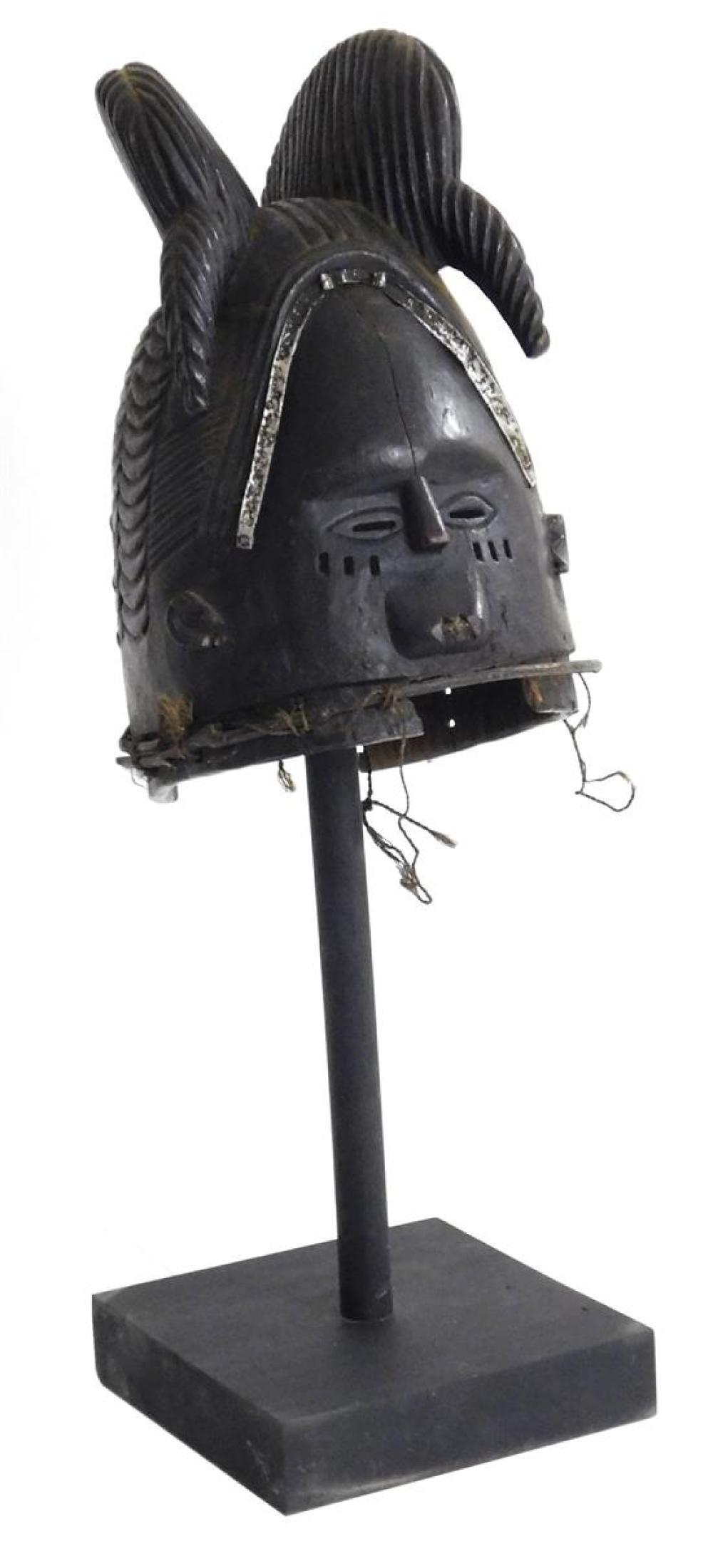 TRIBAL: Mende Helmet Mask, Sierra Leone, 20th C., wood and metal, carved wood helmet mask with multiple hair lobes forming coiffure,...