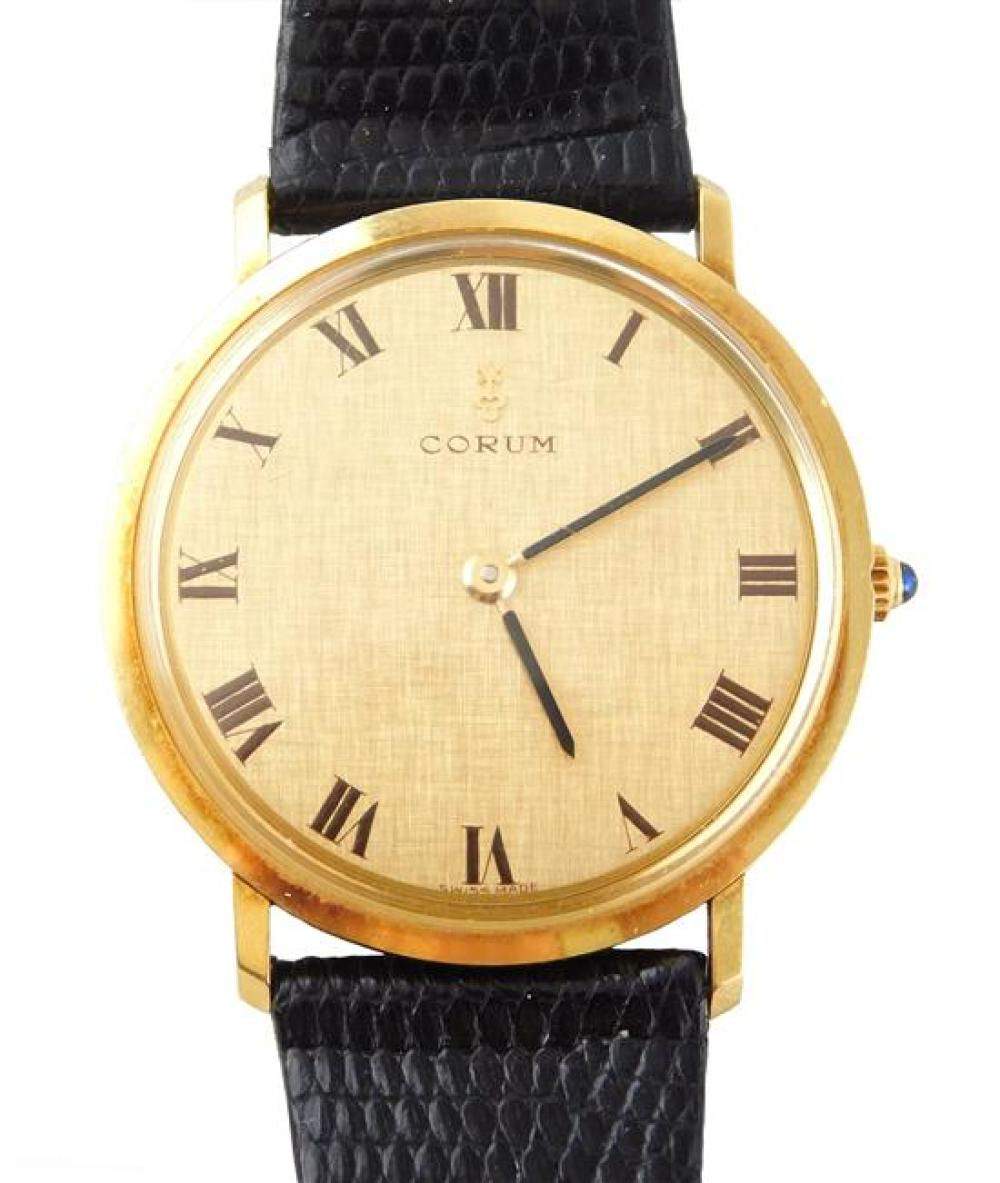 "WATCH: 18K Corum men's wrist watch: movement: manual wind, stamped"" ""Corum, Swiss, Twenty-one jewels, adjusted three positions"", wat.."