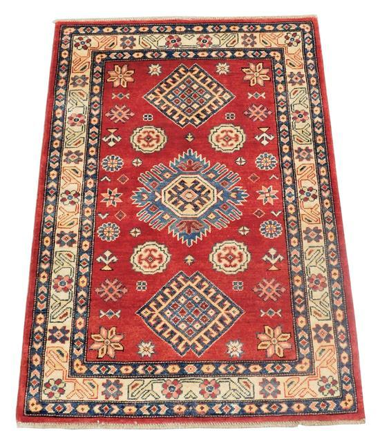 """RUG: Uzbek Kazak 3' 3"""" x 4' 7"""", hand-made, 100% wool, polychrome with classic geometric design, wear consistent with age and use, ma."""