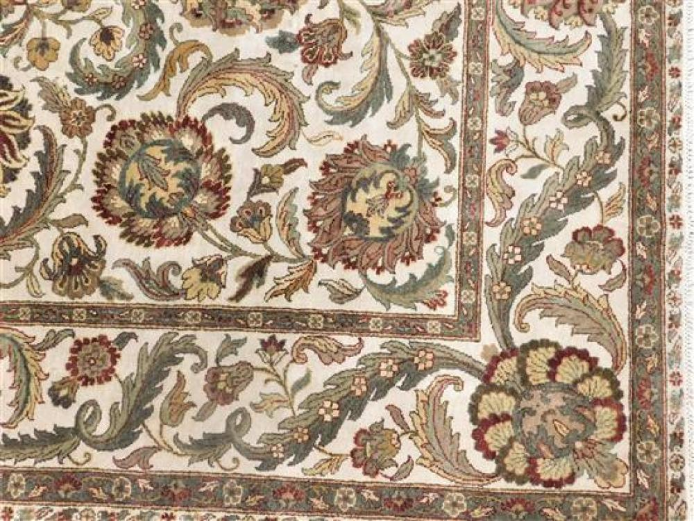 RUG: Modern Indo-Arts & Crafts design, allover floral design on off-white ground with maroon, greens, browns, wear consistent with a...