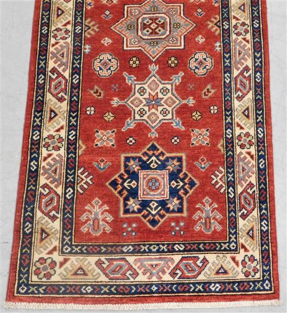 """RUG: Uzbek Kazak Runner 2' 8"""" x 7' 10"""", hand-made, 100% wool, polychrome with classic geometric design, wear consistent with age and."""