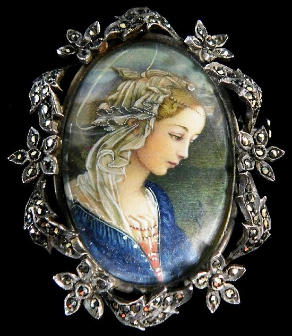 JEWELRY: Continental jewelry, two pieces, including: miniature portrait on brooch, bust of an angel with lace-covered blonde hair an...