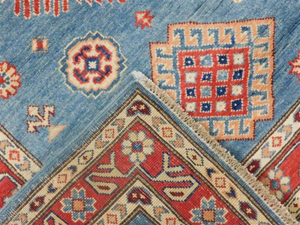"""RUG: Uzbek Kazak 3' 3"""" x 4' 10"""", hand-made, 100% wool, polychrome with classic geometric design, wear consistent with age and use, m."""