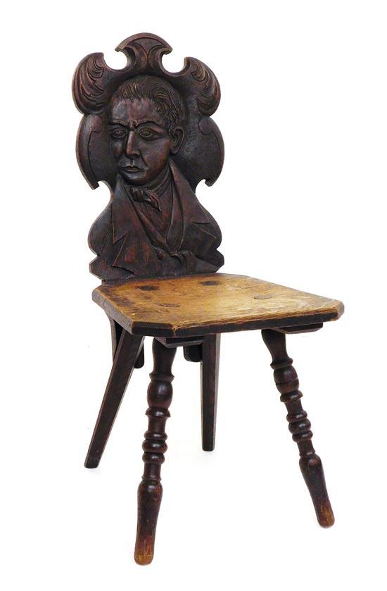 Late 19th/early 20th C. Moravian style side chair, oak with fumed finish, figural carving of man with face turned in ¾ profile carve...