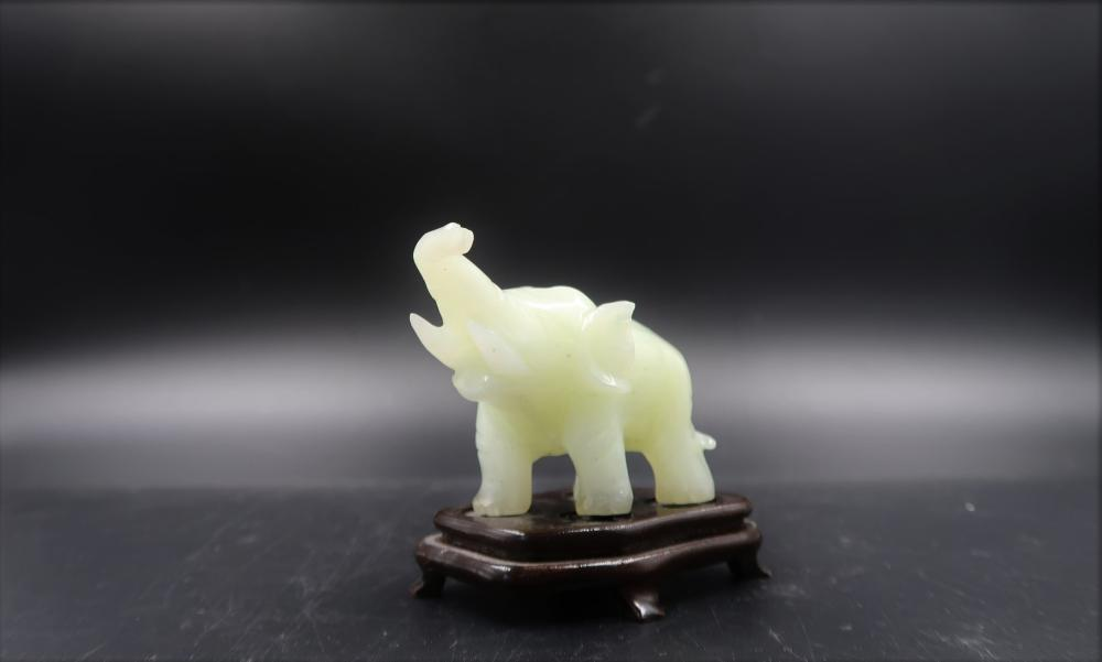 Small Carved Jade Elephant on Wooden Plinth
