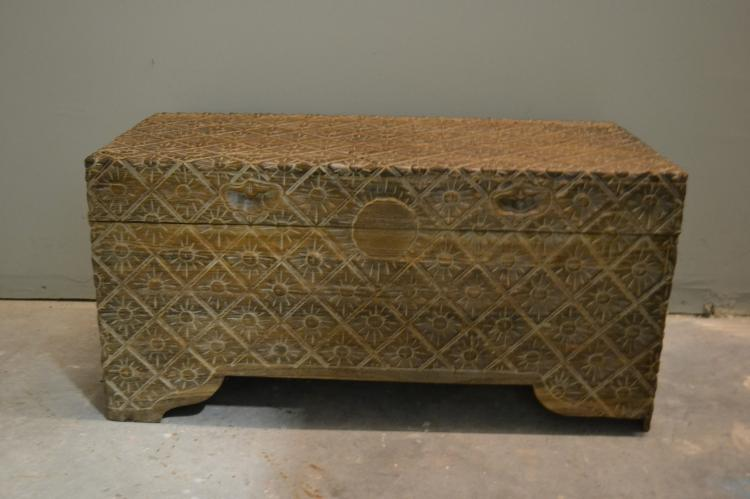 Sun carved wooden chest