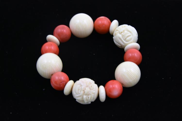 Carved ivory and coral bracelet