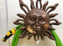 Lot 138: Sunburst Hose Holder & Hose