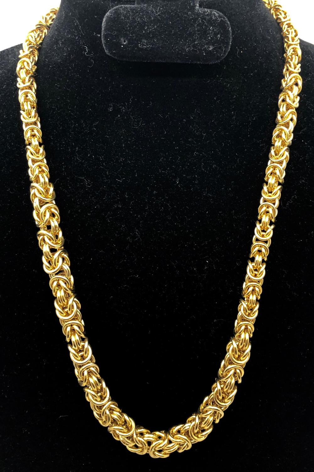 Lot 63: Gold Tone Rope Necklace