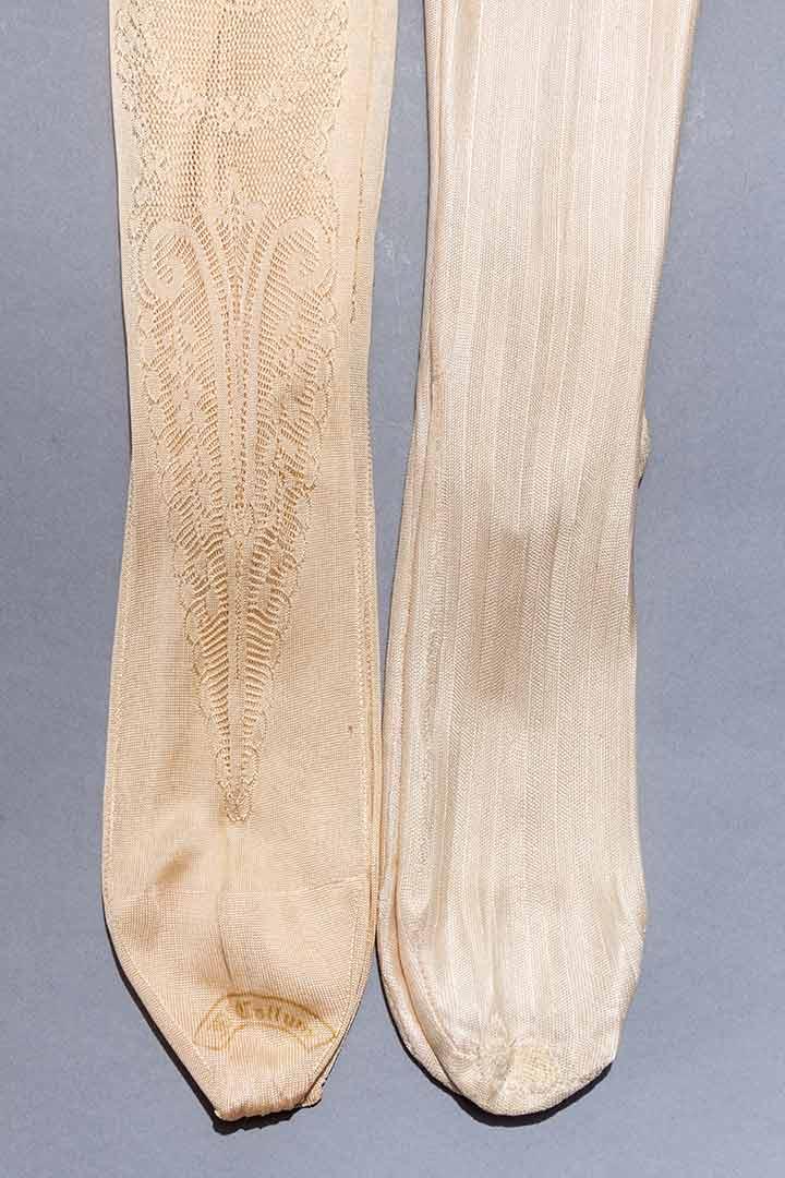 a pair of silk stockings A pair of silk stockings best represents literary - 769776.