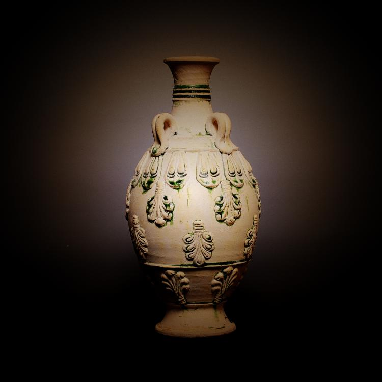 Tang Dynasty A Chinese Tri Color Vase With Relief Deco