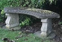 A reconstituted stone, semi-circular garden bench