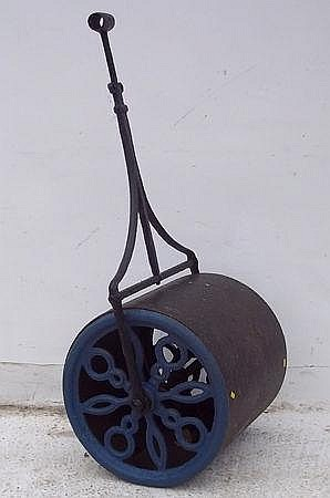A large garden roller, possibly Victorian.