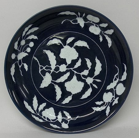 A Chinese blue and white dish decorated with