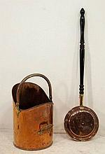 A copper coal bucket and a warming pan with a