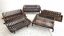 A group of five cast iron fire baskets, largest 56