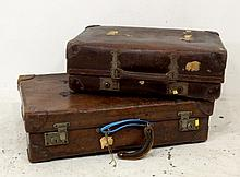A leather suitcase, and a Revelation 1930s