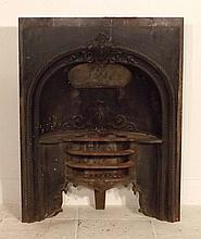 A Victorian cast iron fire grate and surround with