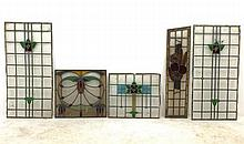 Five stained glass leaded panels, to include an