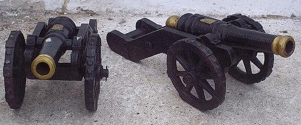 A pair of cast metal garden canon, painted black