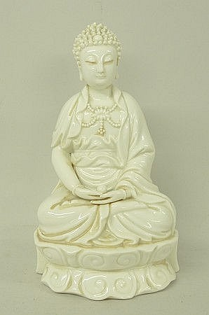 A Chinese blanc de chine porcelain figure of