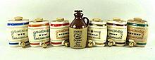 A set of six Royal Victoria Wade pottery barrels,