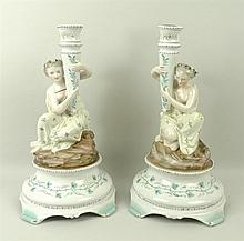 A pair of Dresden figural candlesticks, depicting classical maidens with co