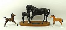 A Beswick figure of Black Beauty and foal, on a wooden base, 21cm, a gloss