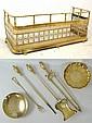 A Victorian pierced brass fender, a set of brass