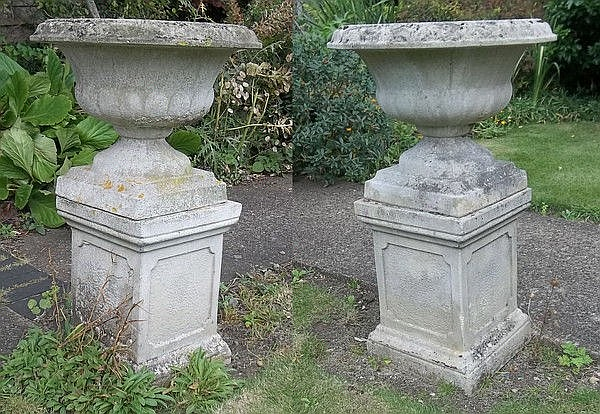 A pair of reconstituted stone campana style urns