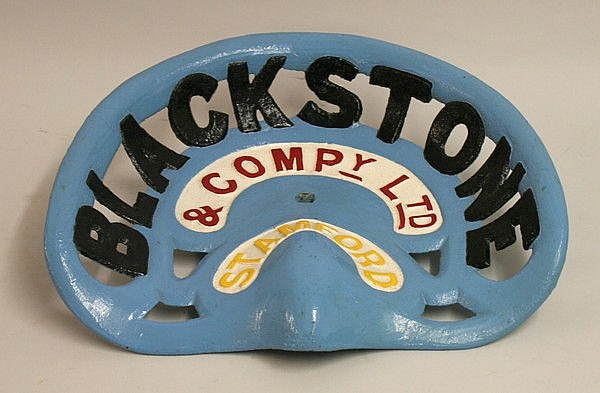 A cast iron tractor seat for Blackstone and Compy