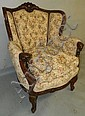 Carved wood wing back chair with rams head arms