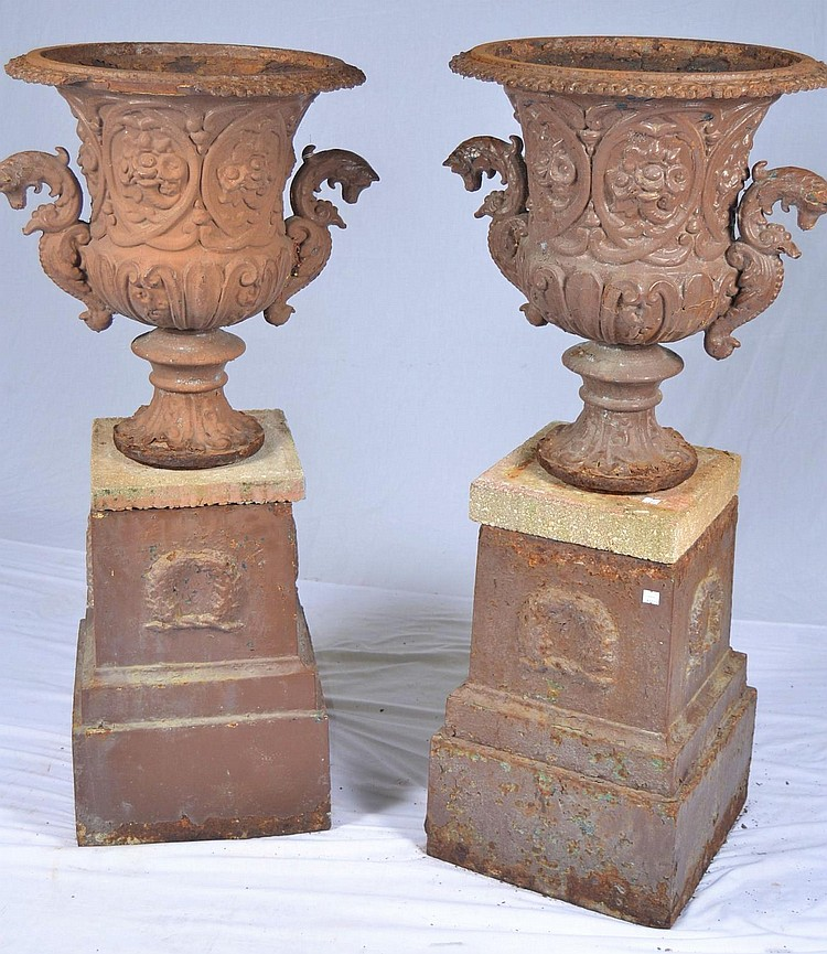 Pair of cast iron garden urns with bases