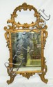Mirror in ornate gilt carved frame