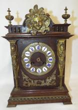 Mantle Clock With Figural Mounts